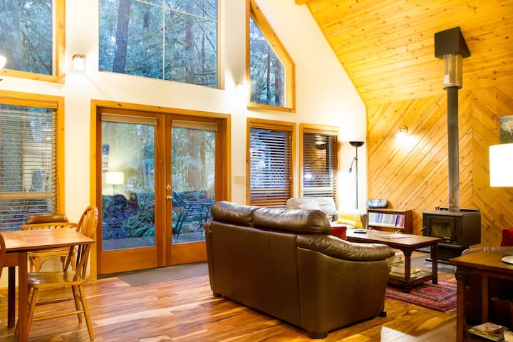 Open floor Plan Great Room with fireplace and French doors to a large deck