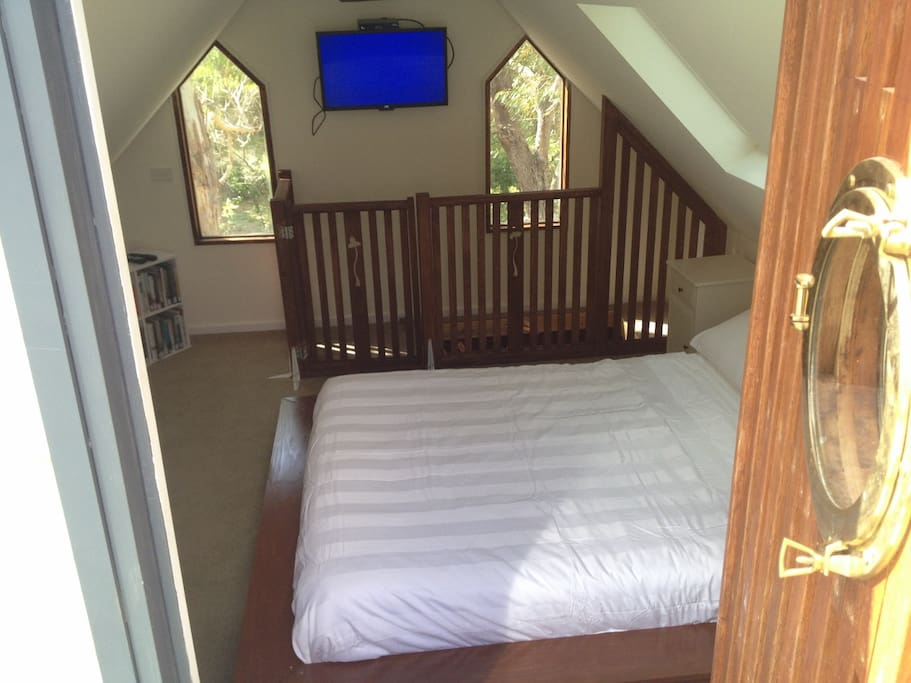 Upstairs  loft bedroom, accessed by retractable stairs.