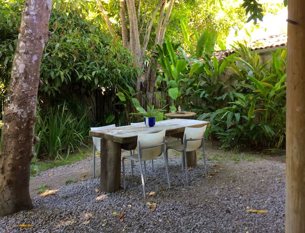 dining table outside nesr the outdoor shower