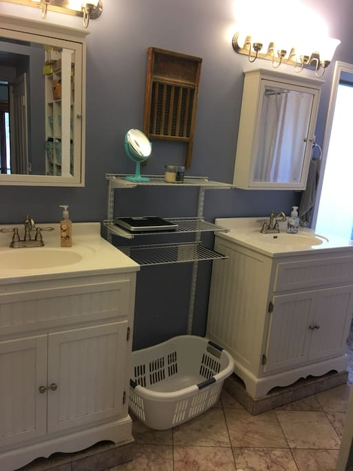 First floor full bathroom with double vanities