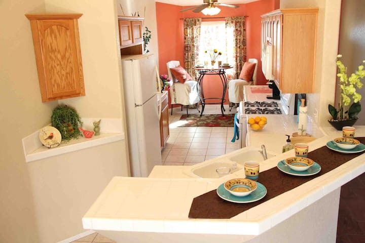 The galley kitchen welcomes conversation and seating on each end.