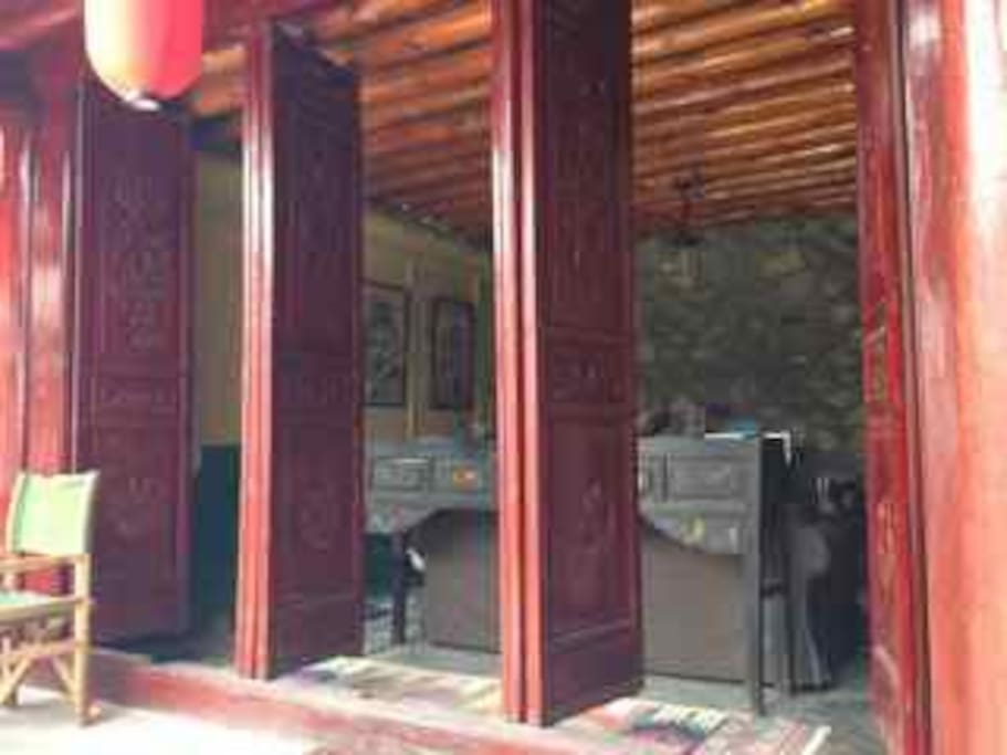 TV room with Chinese front doors