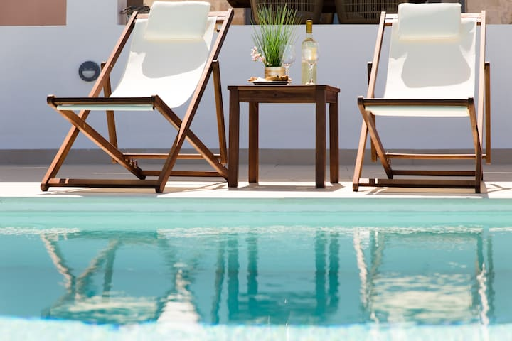 Lay by the pool and enjoy the sun all day long