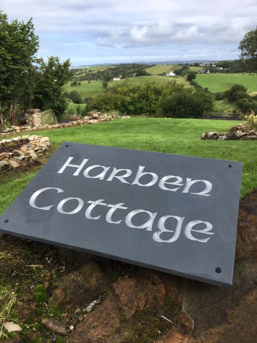 New Sign. Temporarily sitting on the big rock in the garden