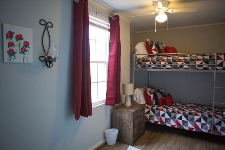 Downstairs bedroom with twin bunk beds (bunk beds are rated for adult weight)