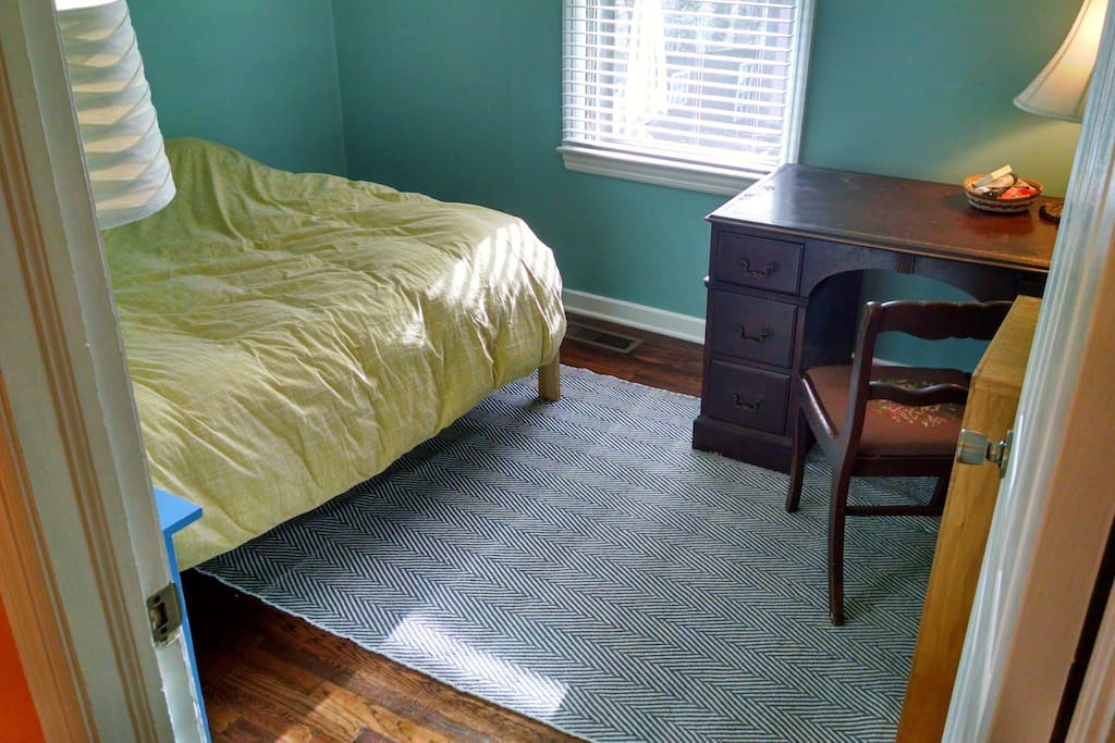 Queen size bed with a down topper.