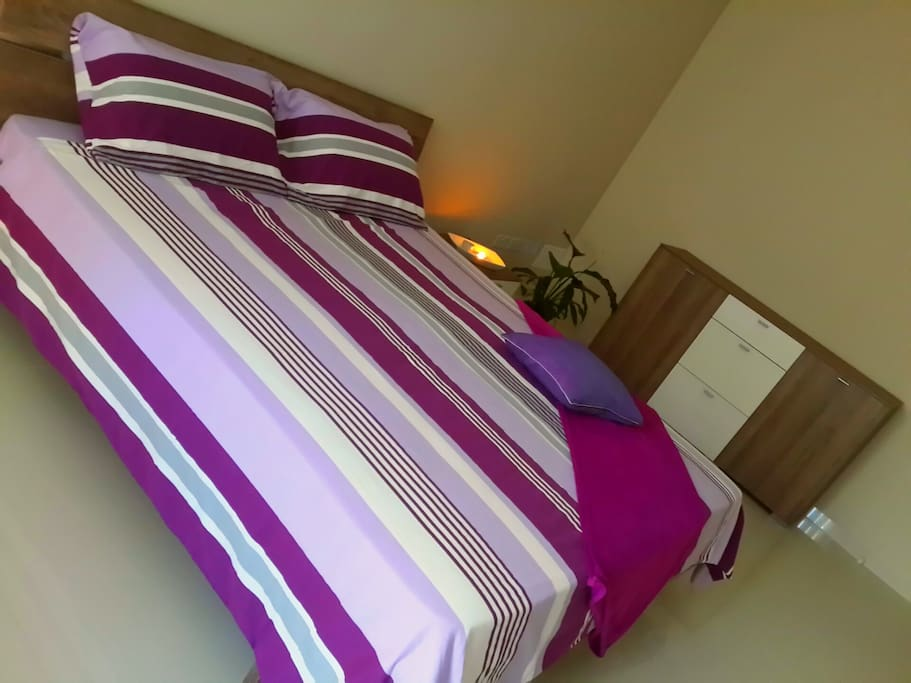 Queen size bed, linen included.