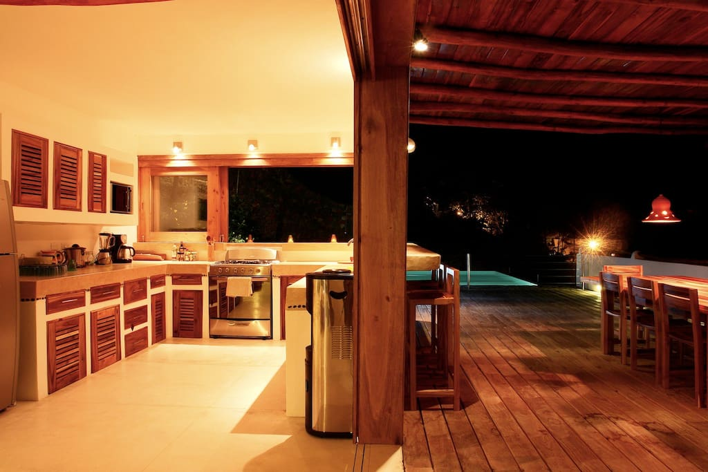 Terrasse with sun deck and kitchen are opened on the infinity swimming pool