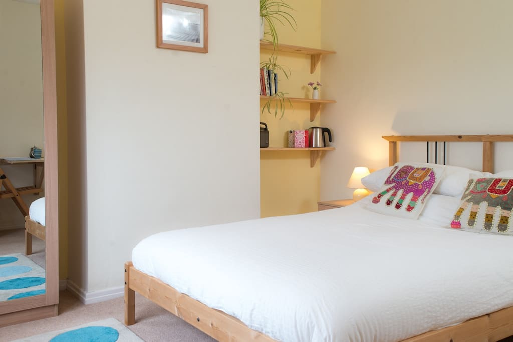 Your bedroom - a comfy double bed and space for travelcot or roll-out bed if you need it.