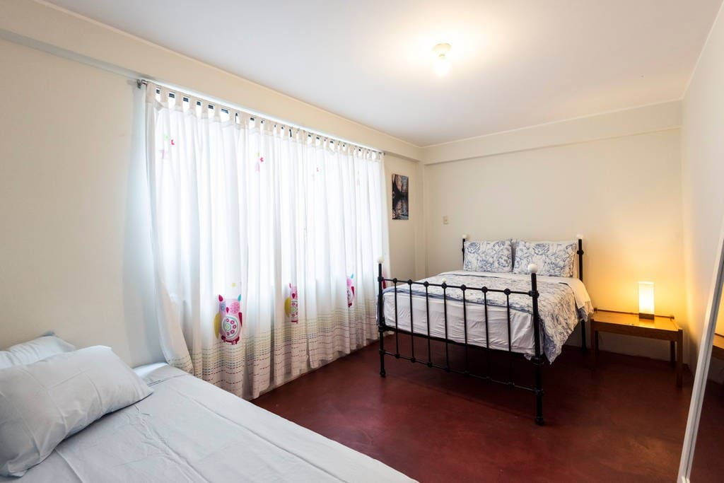 Room 1 with 1 Double Bed and 1 single Bed