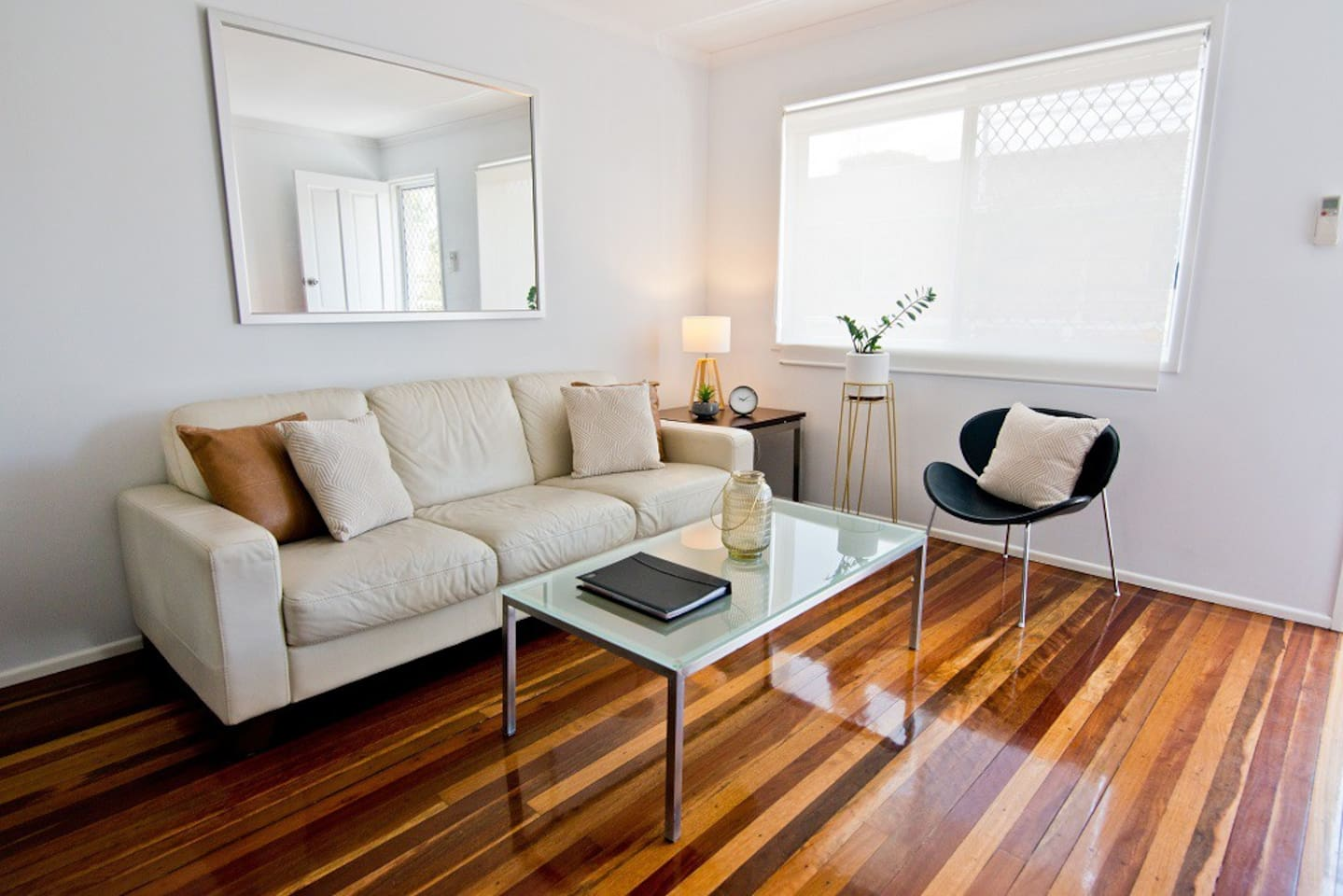 Apartment 1: Modern open plan air-conditioned living area