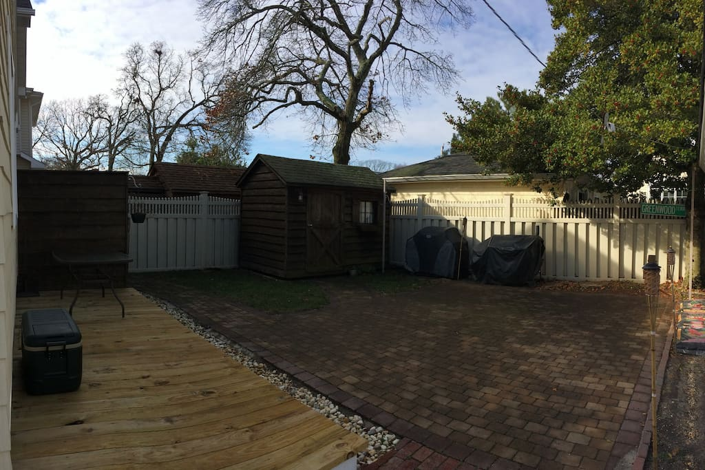 Spacious backyard with outdoor shower and grills