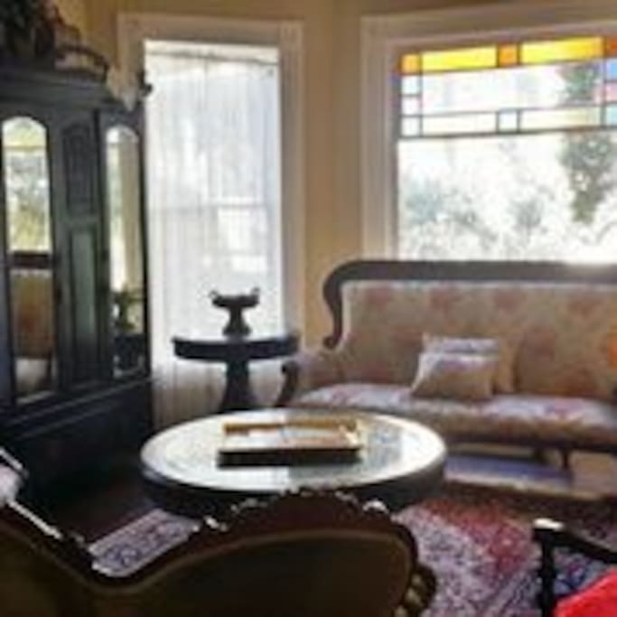 A view of the front sitting parlor decorated with antiques and furniture from the Middle East
