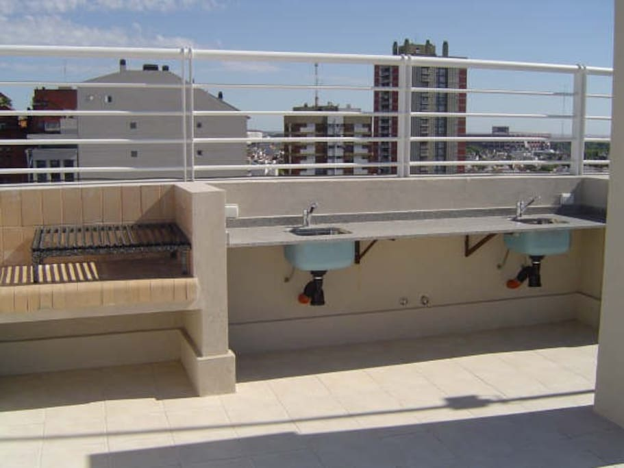 Common use roof top with BBQ grill and water access for food preparation