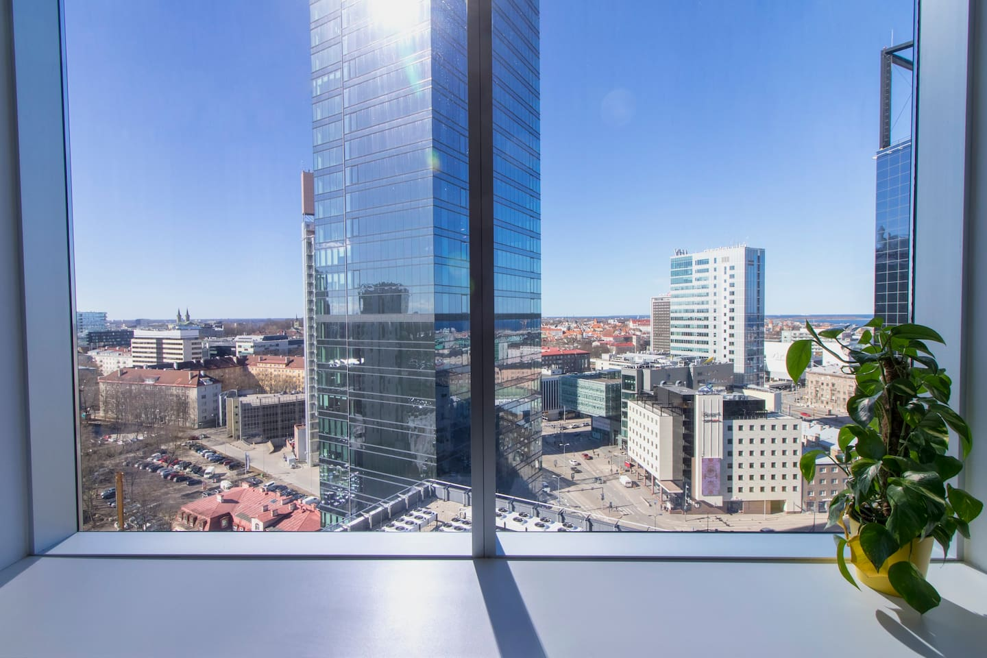 The apartment overlooks the modern city center of Tallinn, as well as part of the bay, with a stunning view through the huge windows.