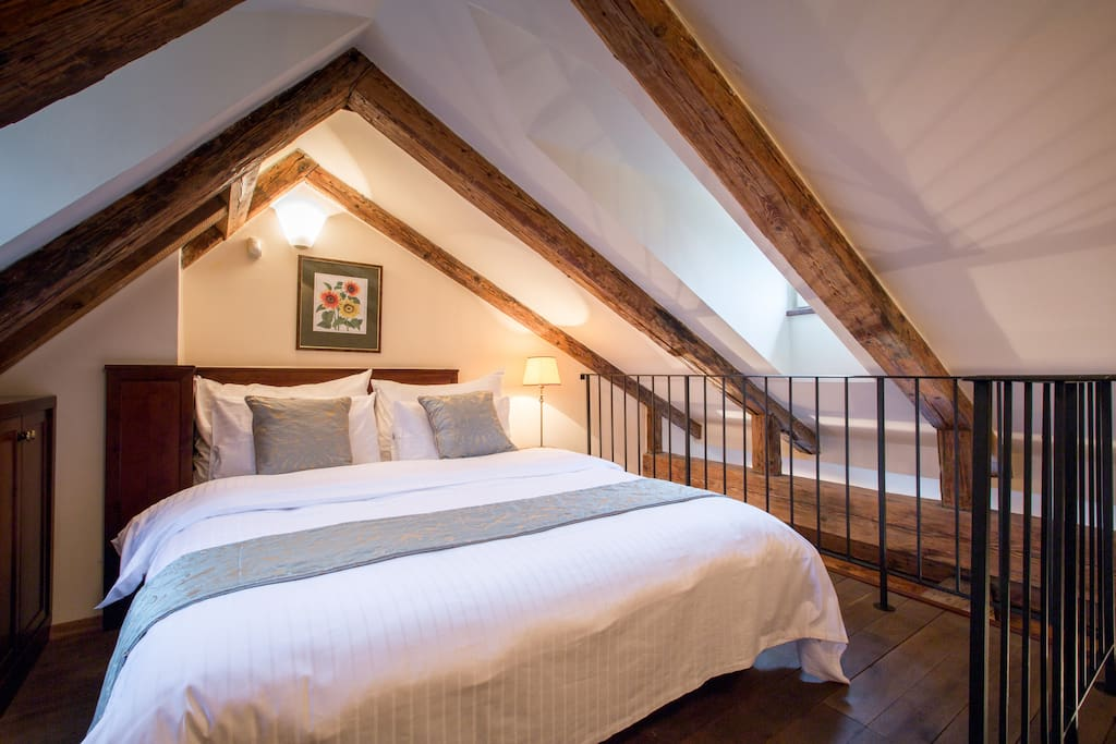 Loft sleeping area with king size bed