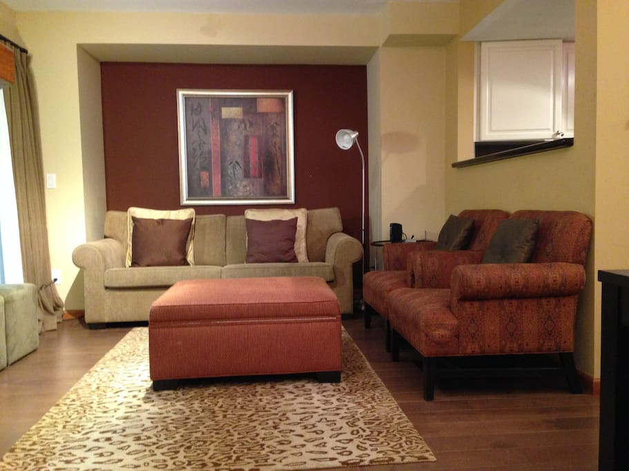 comfortable living room with flat screen tv and gas fireplace