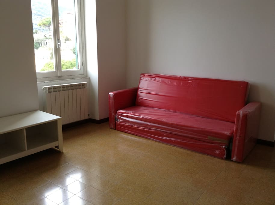 living room with matrimonial sofa bed