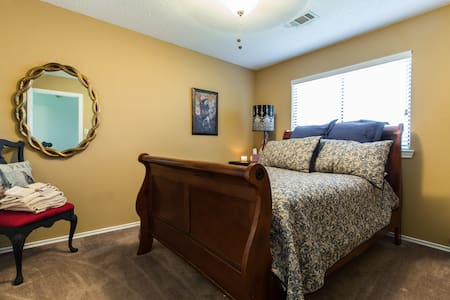 Full sized bedroom - House