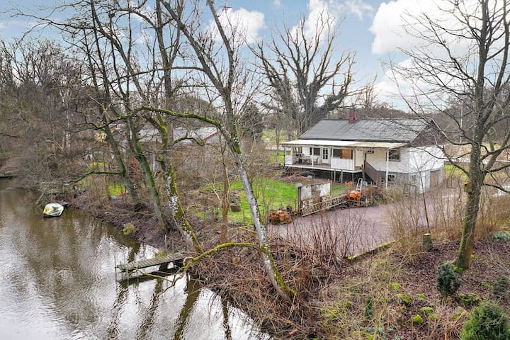Country house alongside river and forest
