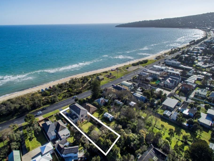 Located directly across from the beach with walking path access