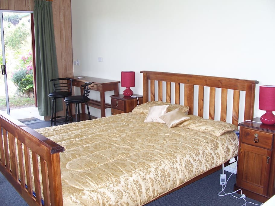 Inside your accommodation comfortable Q size bed