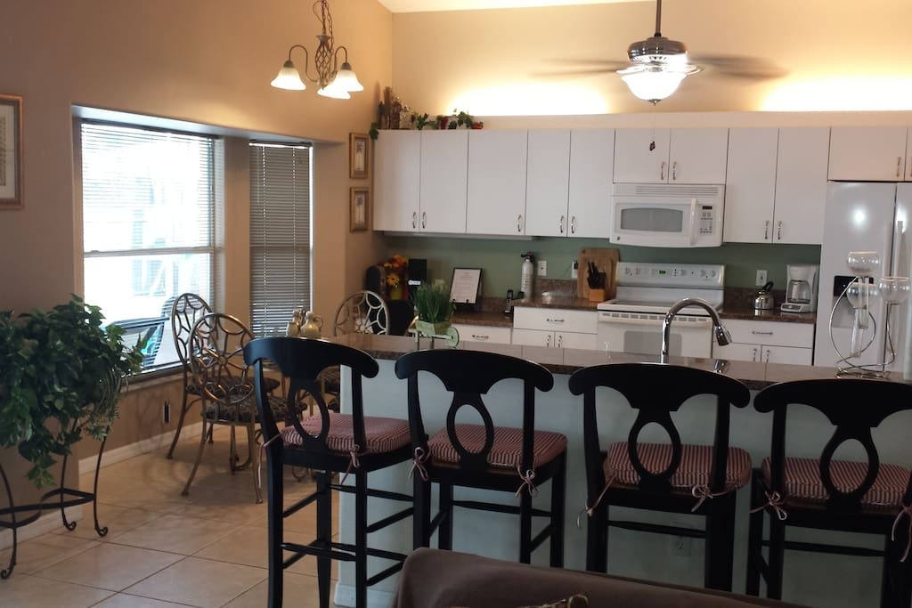 Open concept kitchen with bar or table dining.