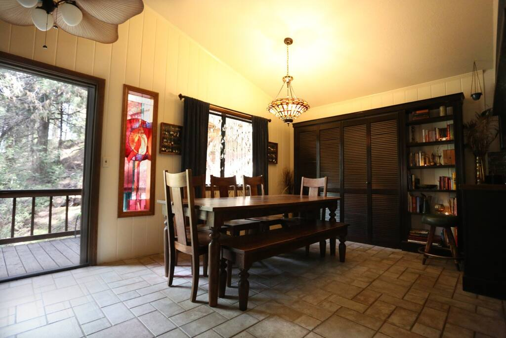 Dining room with built in book shelf and laundry nook.