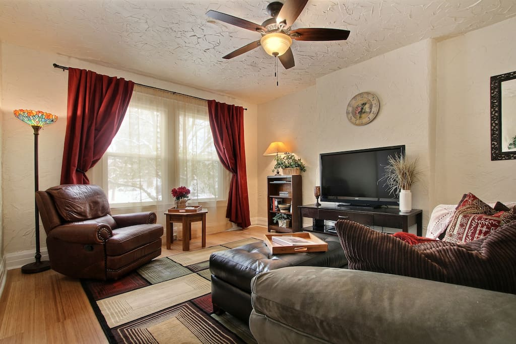 Living room with Large windows, ceiling fan, HD cable TV