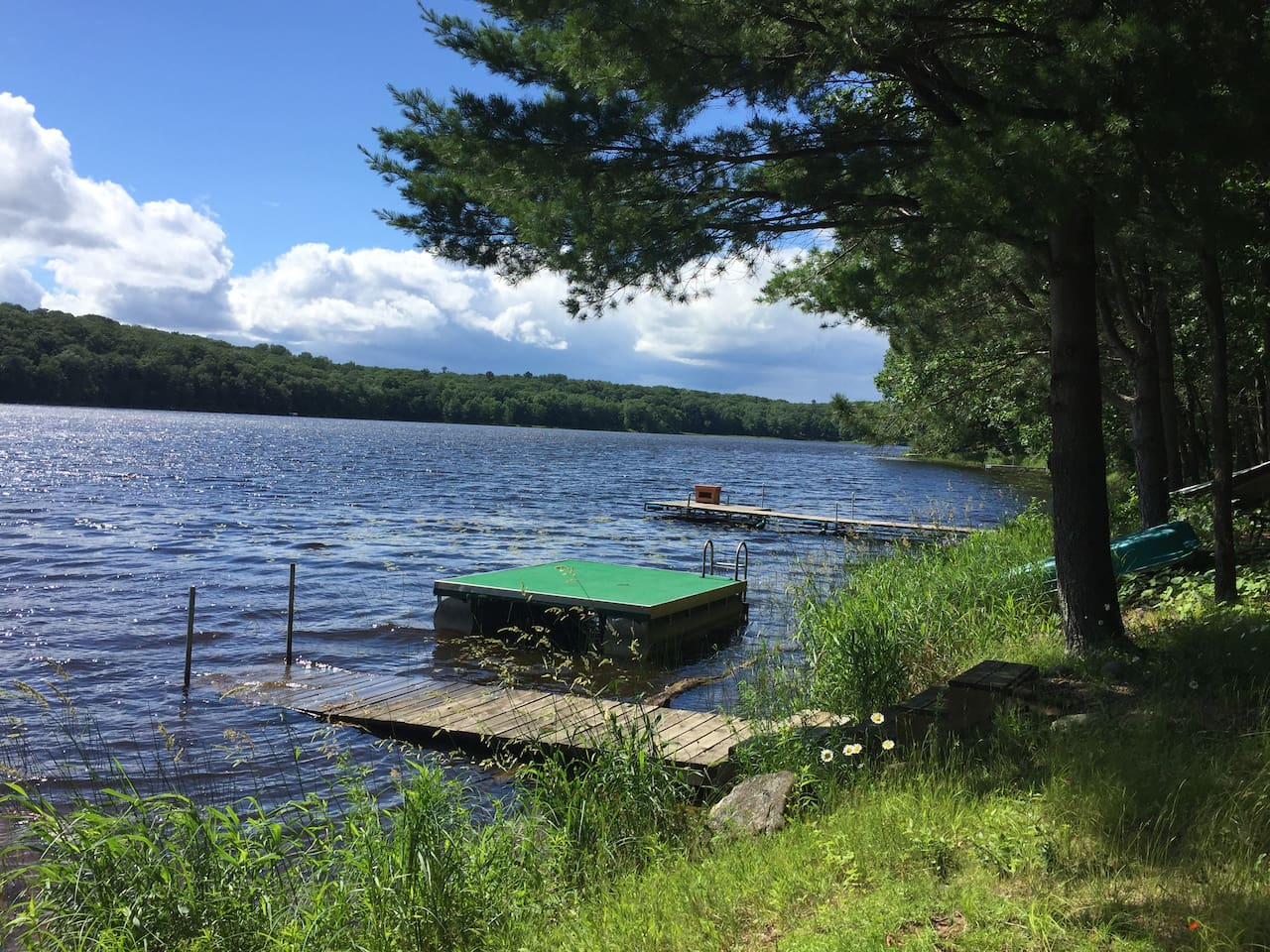 Waterfront has a float, canoe, fishing boat, and a main dock. Located on a small, wooded, low activity, lake. It's a very quiet lake but the noises you will hear are loons, bullfrogs, and owls.  This lake is known to be a good fishing lake.