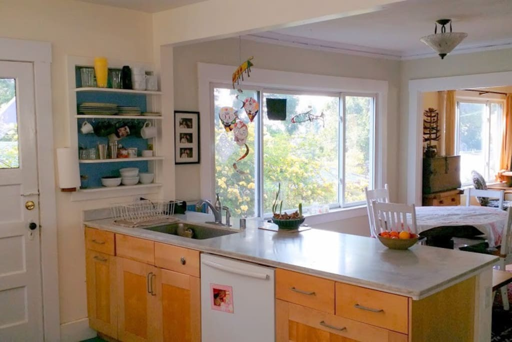 Open kitchen with eating counter and dinning room table.
