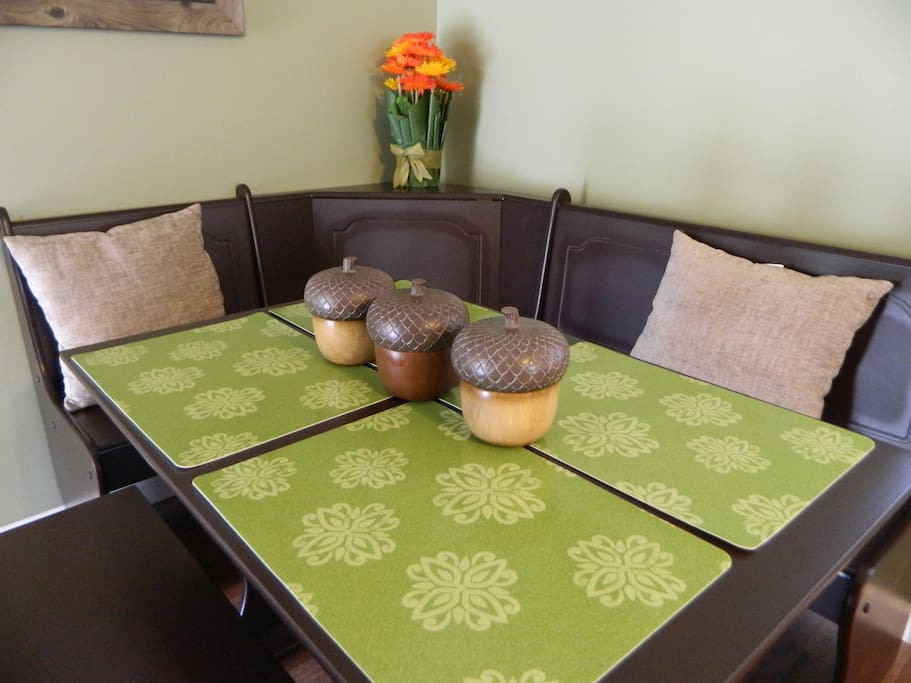 Enjoy family time around the rustic dining table with bench seating.