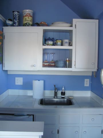 Kitchenette with microwave, coffee pot, hot water pot & electric fry pan.