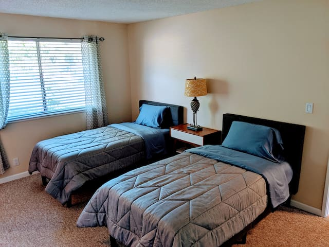 Master suite with two beds. Beds can be combined together into a king size bed upon request.