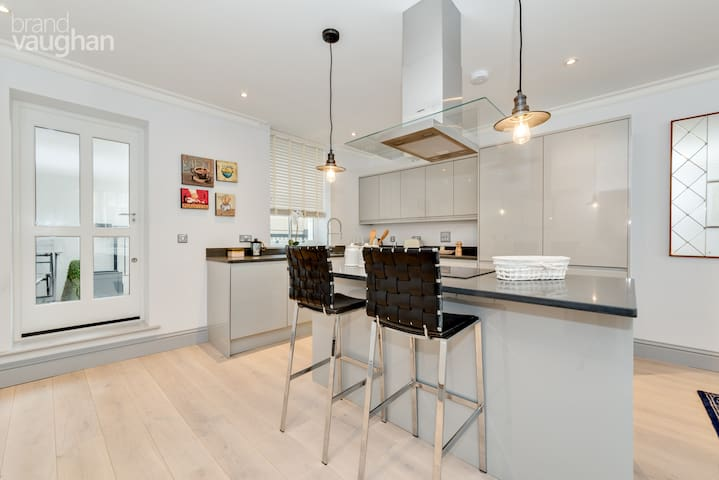 Open-plan kitchen with a rear terrace