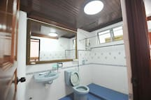 Bathrooms with hot water shower with wooden details ceiling