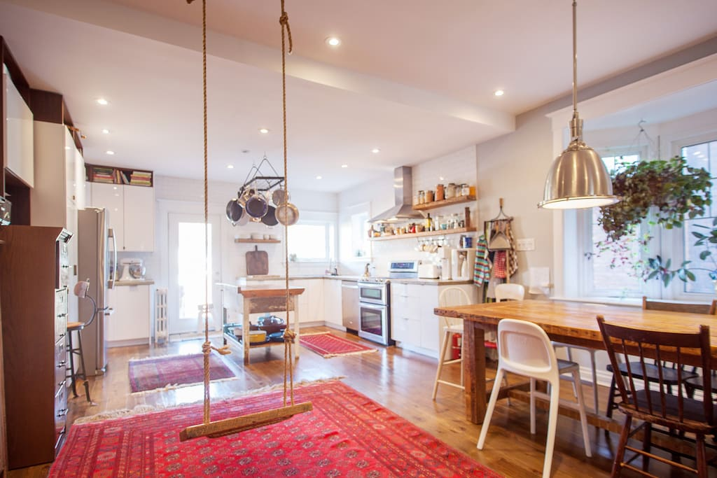 Big, open concept kitchen and dining area, with seating for 10 at the harvest table. And a real swing.