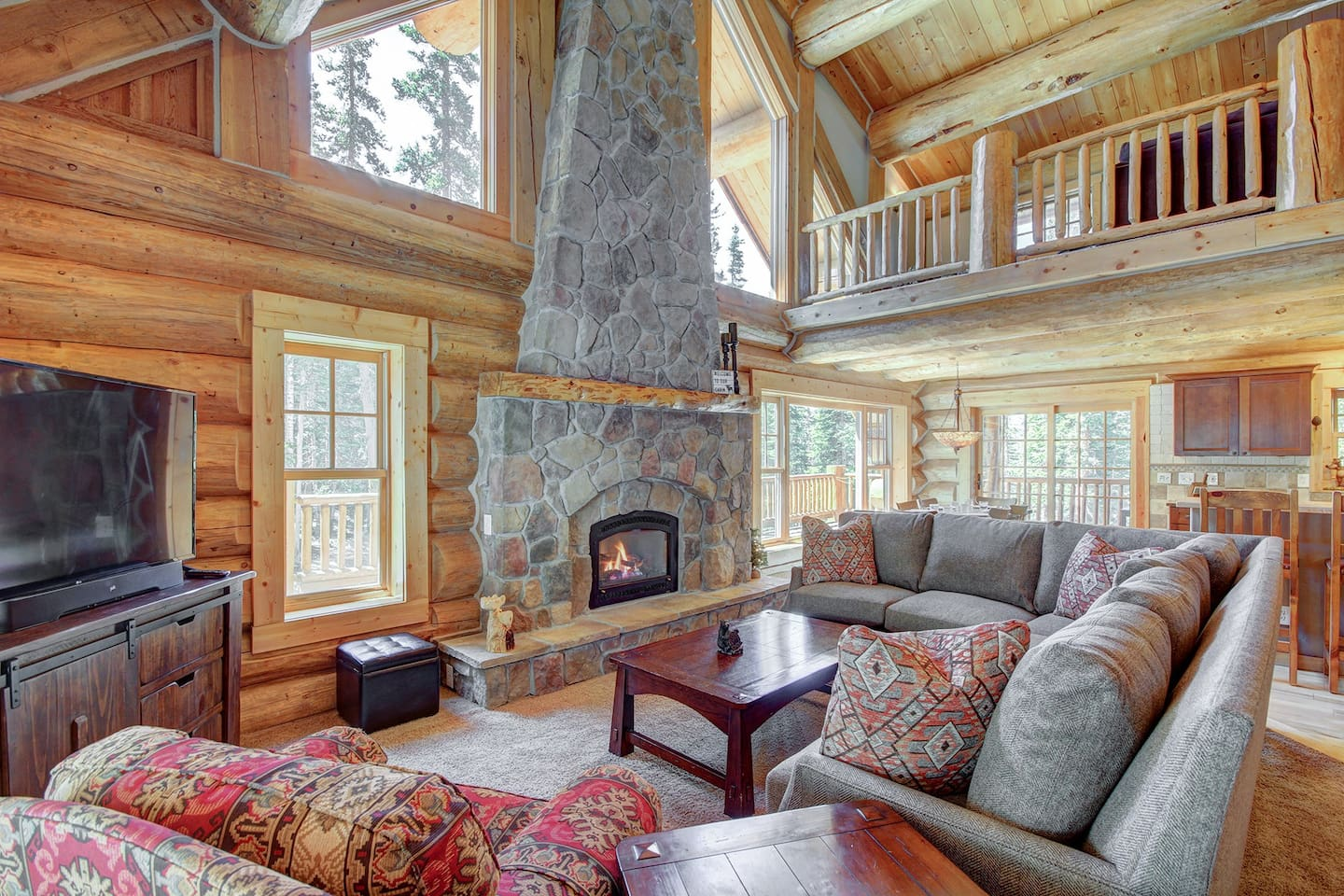 Timber Ridge Lodge - a SkyRun Breckenridge Property - Spacious living room with gas fireplace and flat screen TV