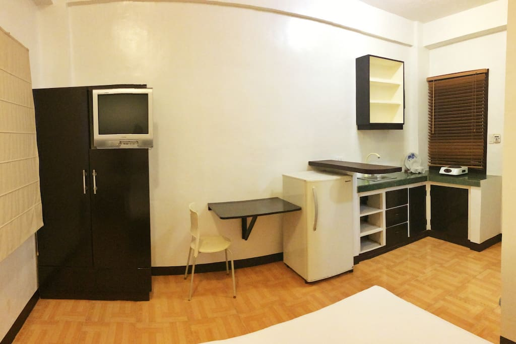 Spacious room with own kitchen and utensils to use for cooking.