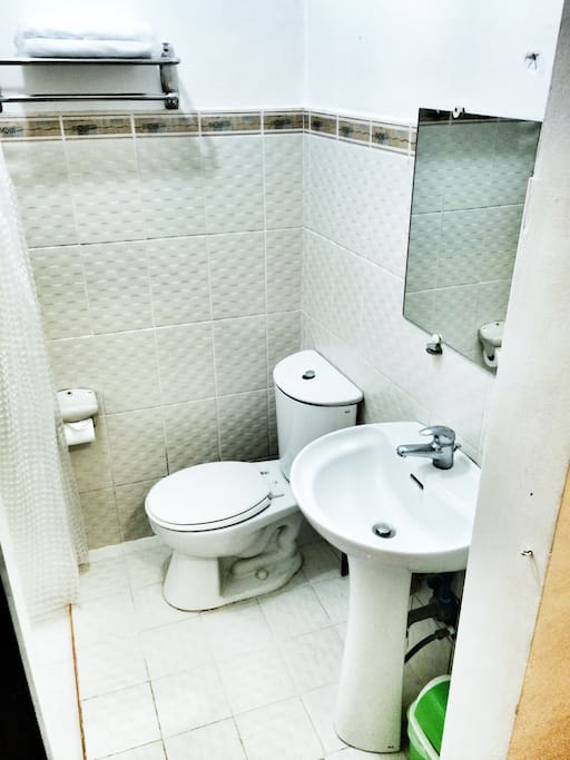 Clean bathroom and hot shower together with amenities provided for the guest.