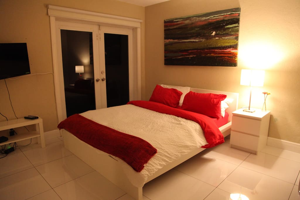 A nice clean spacious, tastefully decorated bedroom, with a queen size bed.