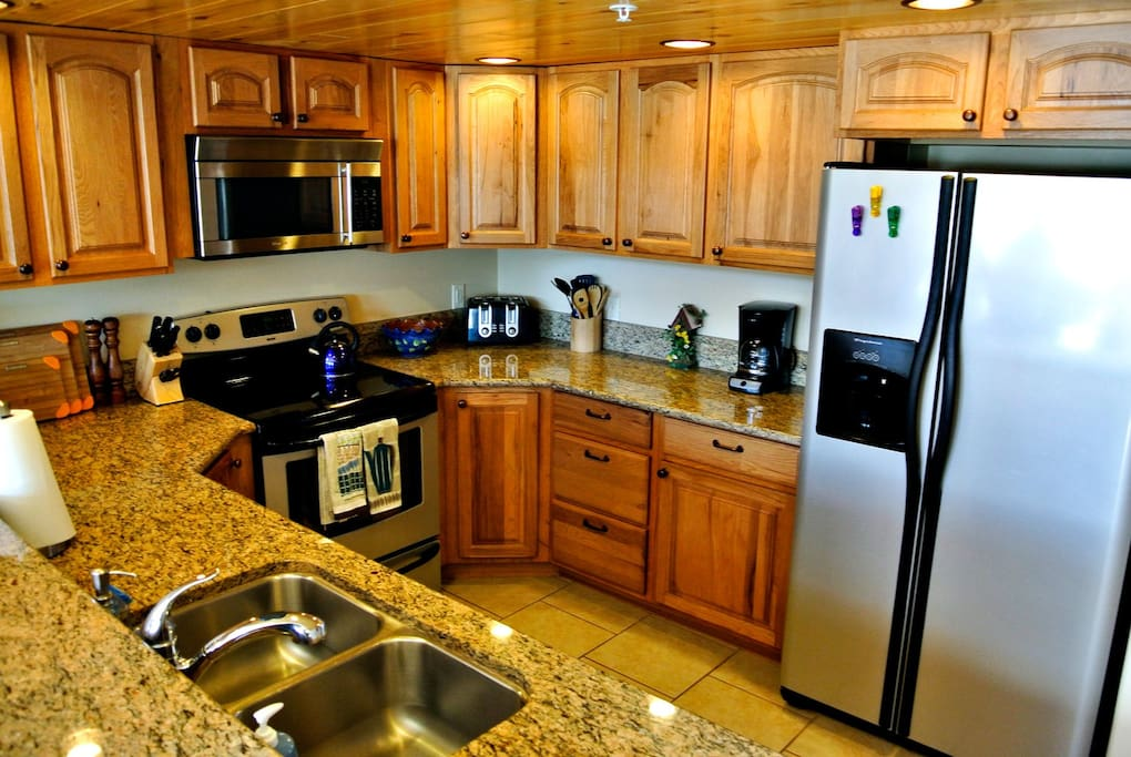 All appliances, cookware, utensils, dishes etc.