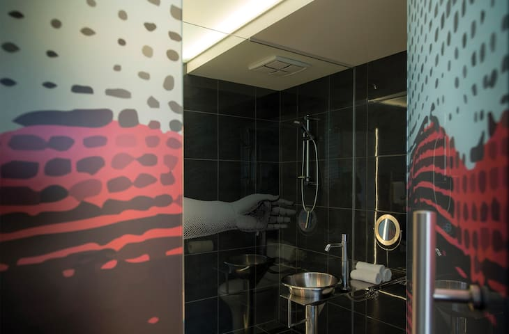 Large glass bathroom with translucent large scale graphic