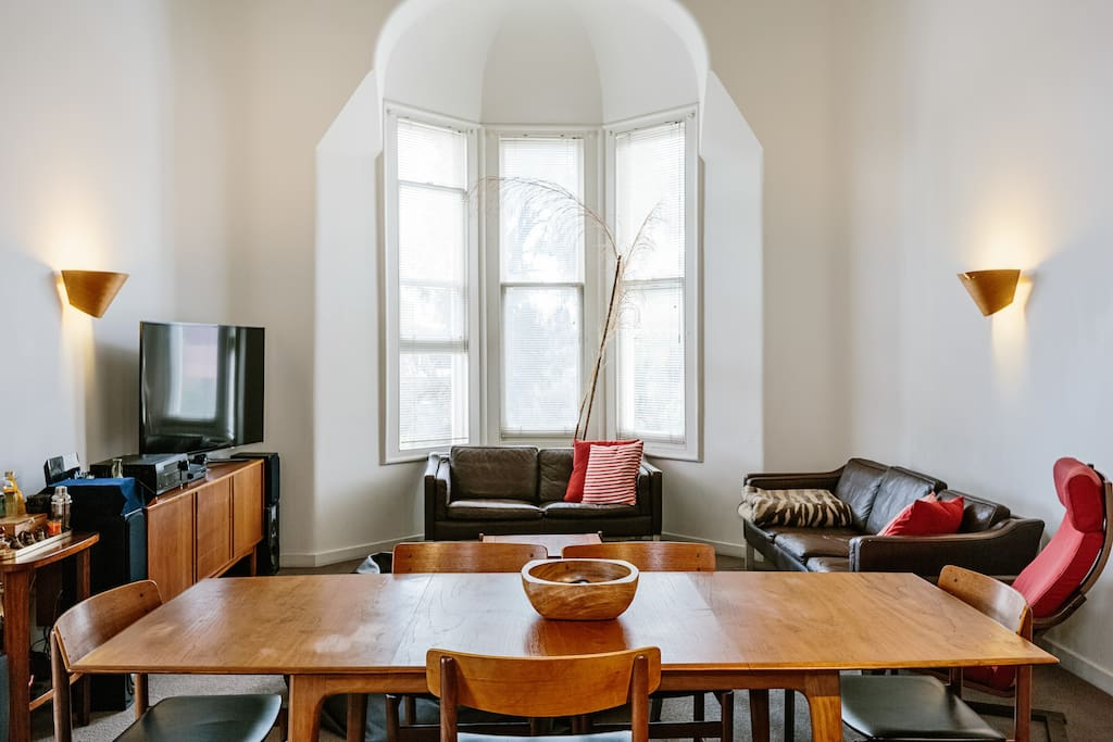 Living room bay windows. six person dining table adjoining living room sitting area