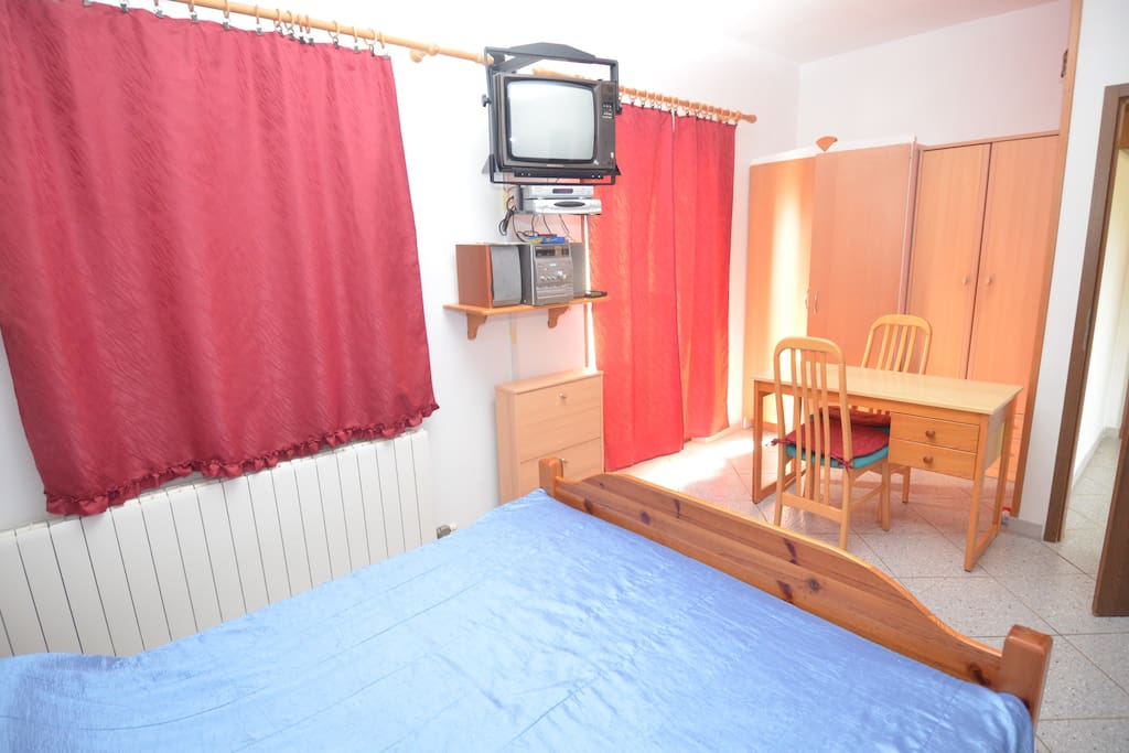 Studio apartment - ground floor; it has one bedroom with a double bed.