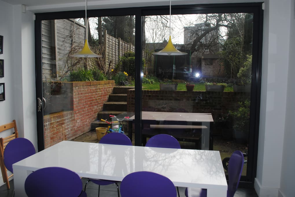 Kitchen diner into garden (not sure if you can make out the trampoline, but it's there and bouncy)