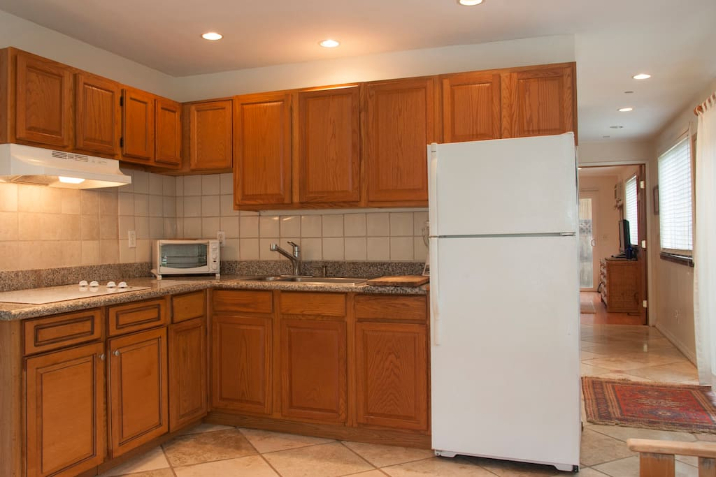 Our oak kitchen cabinets and granite counter,with glass flat top cook stove...