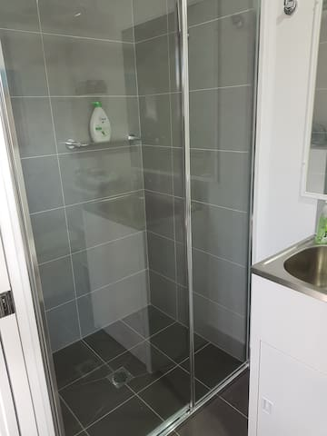 Good size shower with bodywash and shampoo provided.