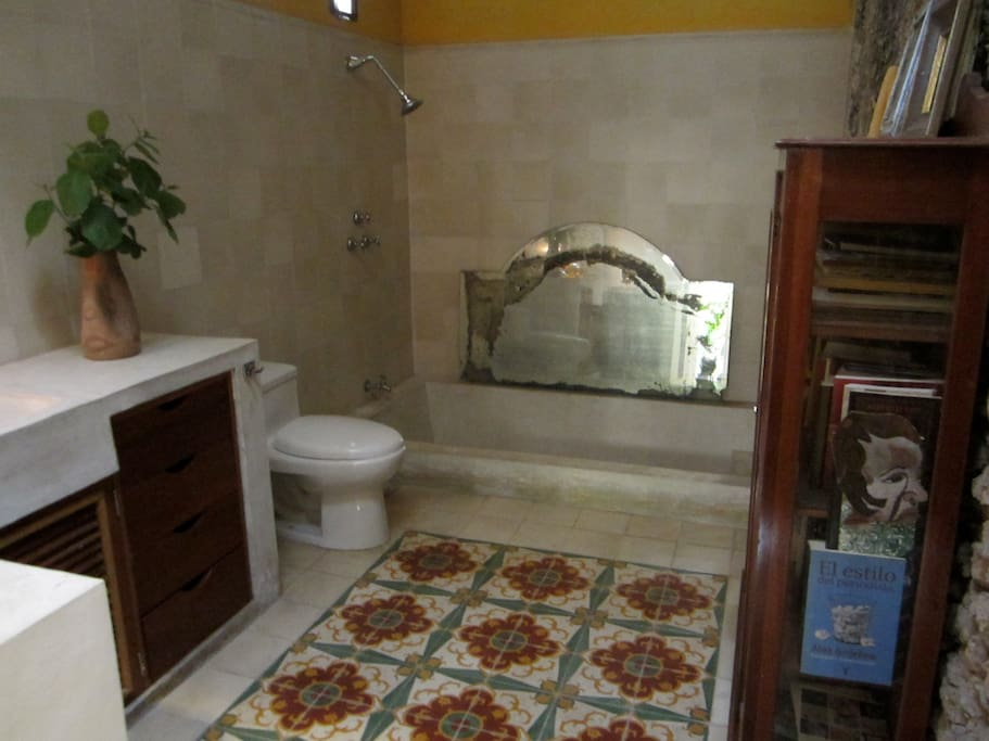 Private bathroom with inlayed concrete tub