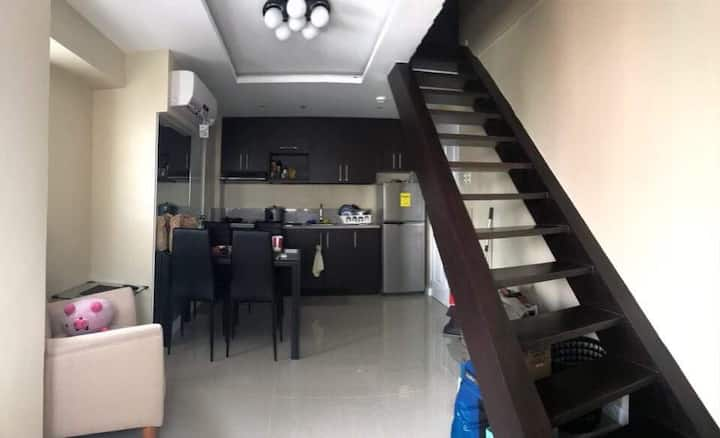 Condo unit (loft type) 2BR w/ mini walk in closet  Furnished & space for entertainment